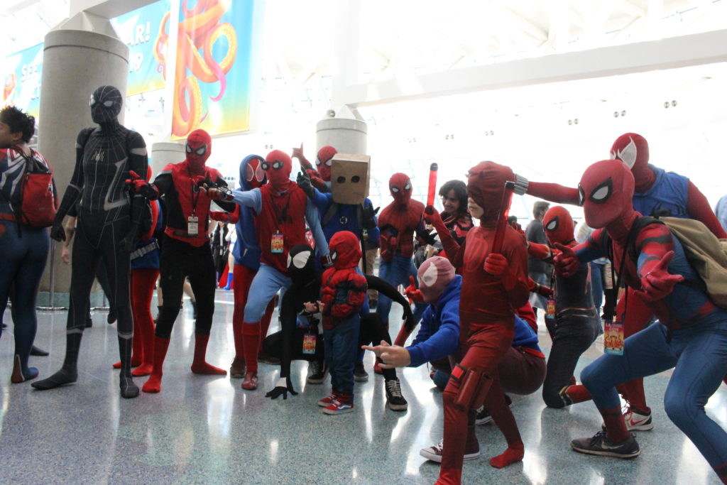 A group of Spider-Man cosplayers pose at LA Comic Con 2018.
